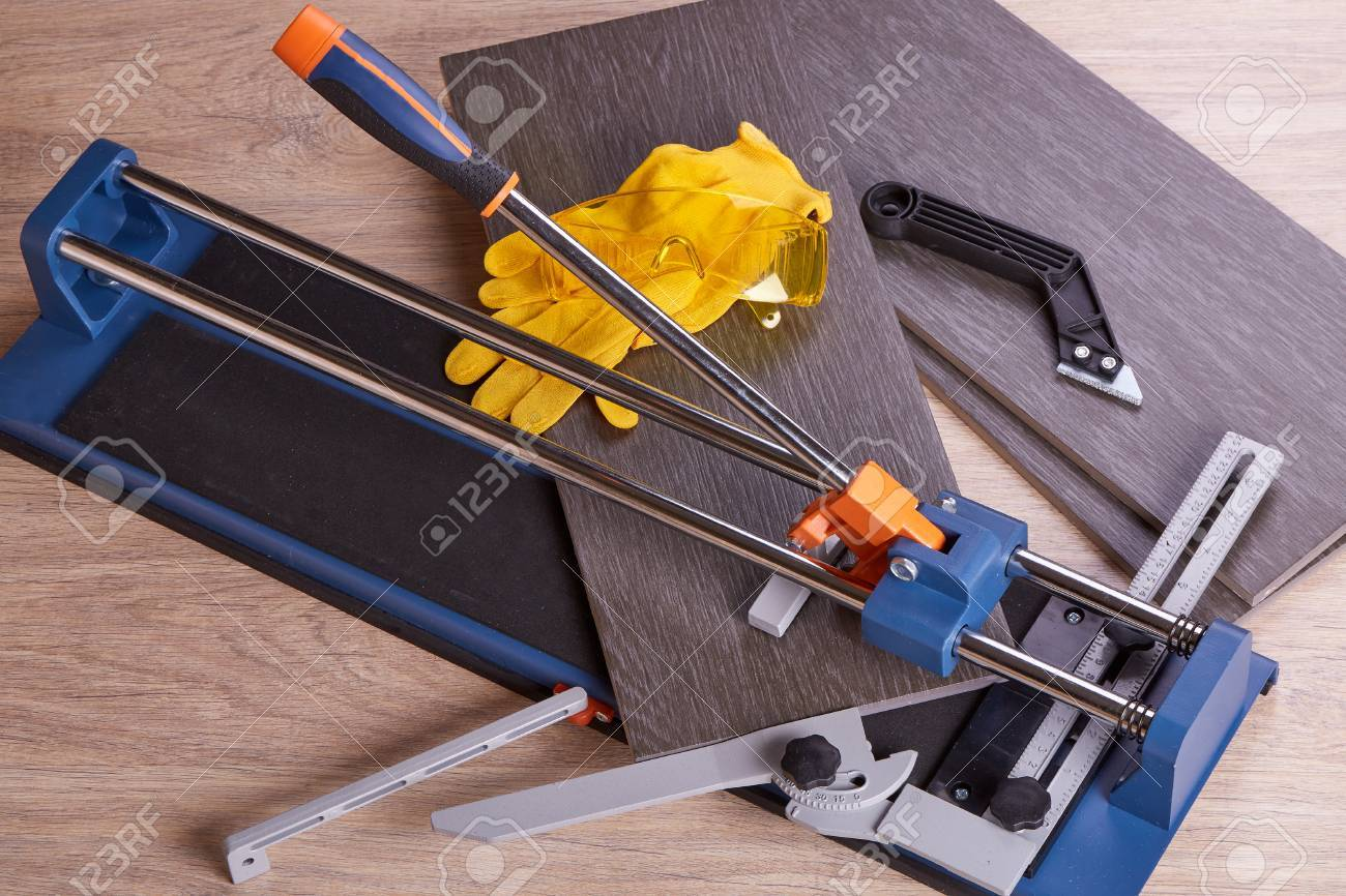 Manual cutter and ceramic tiles for floor home repair stock manual cutter and ceramic tiles for floor home repair stock photo 61003819 doublecrazyfo Gallery