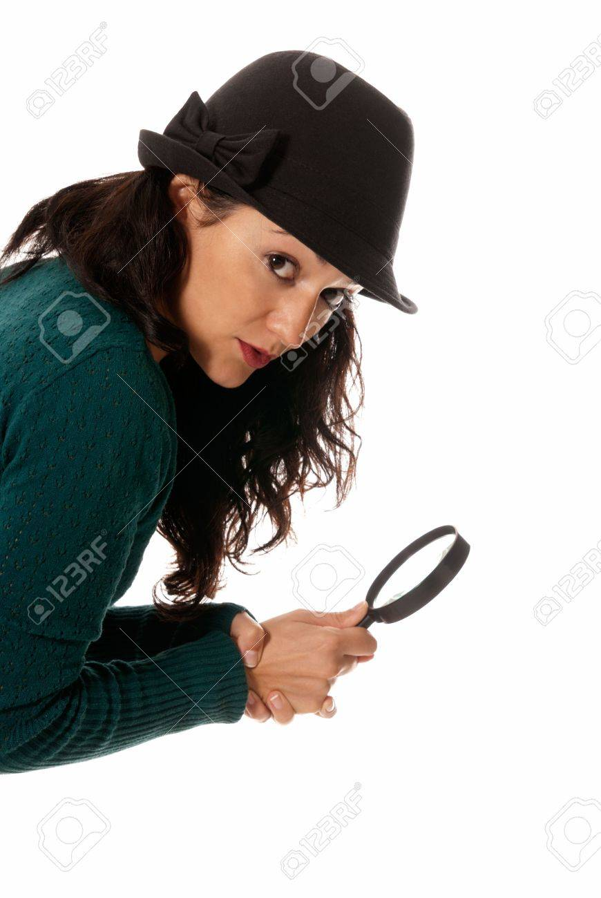 young woman with magnifier glass and hat looking to camera isolated on white background Stock Photo - 8201569