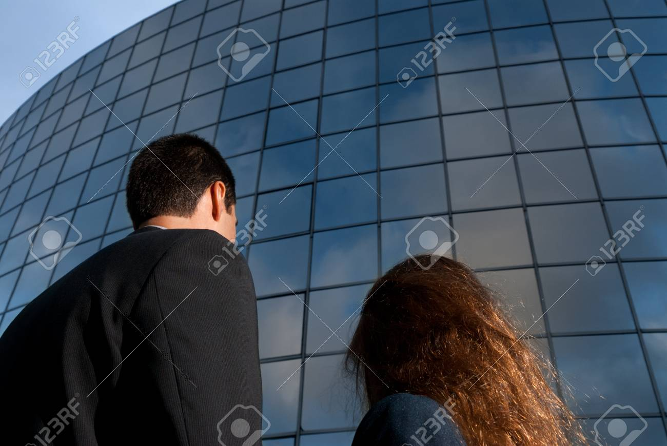 Business people looking good expectations on modern building background Stock Photo - 9682031