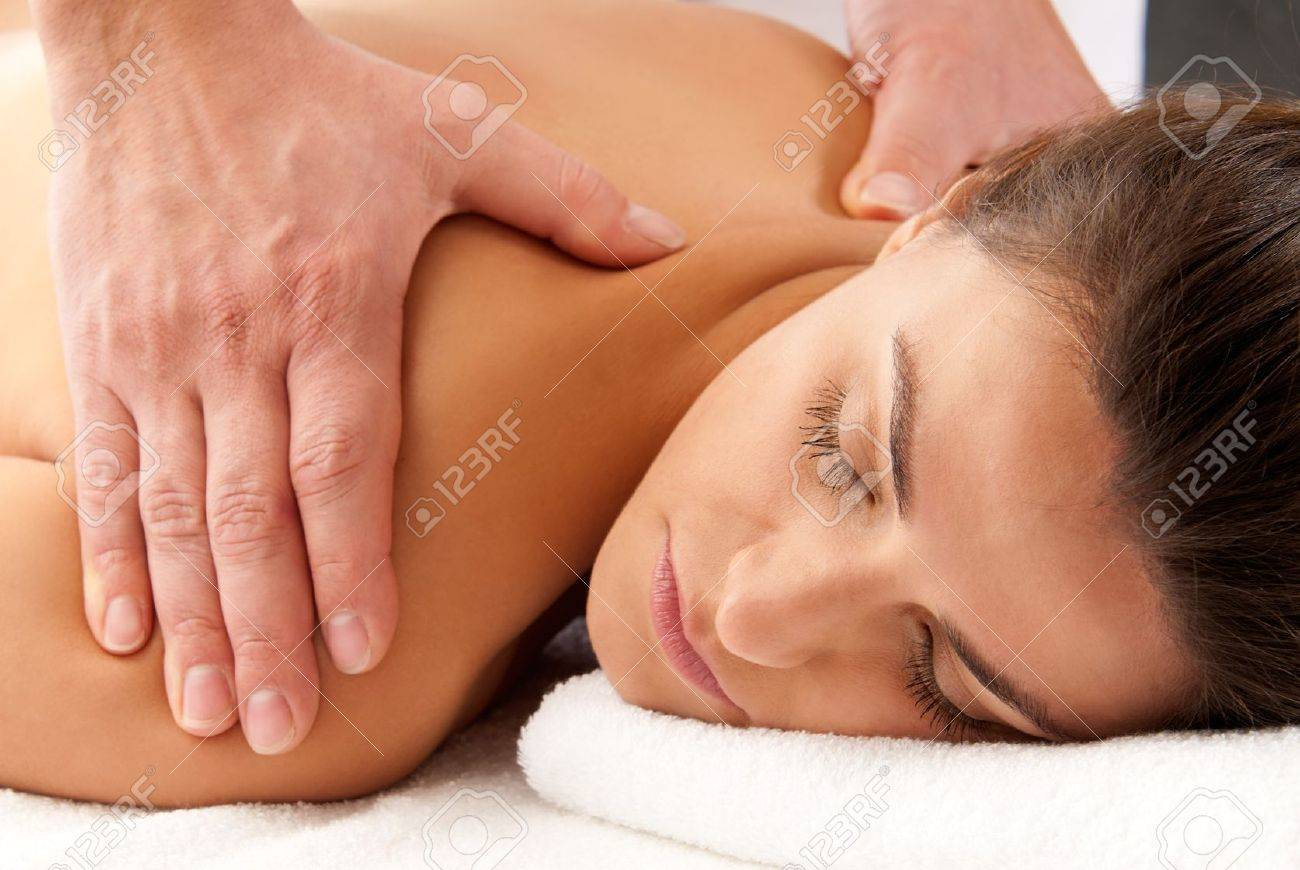 Man woman massage relax treatment close-up  portrait from male hands Stock Photo - 9682030