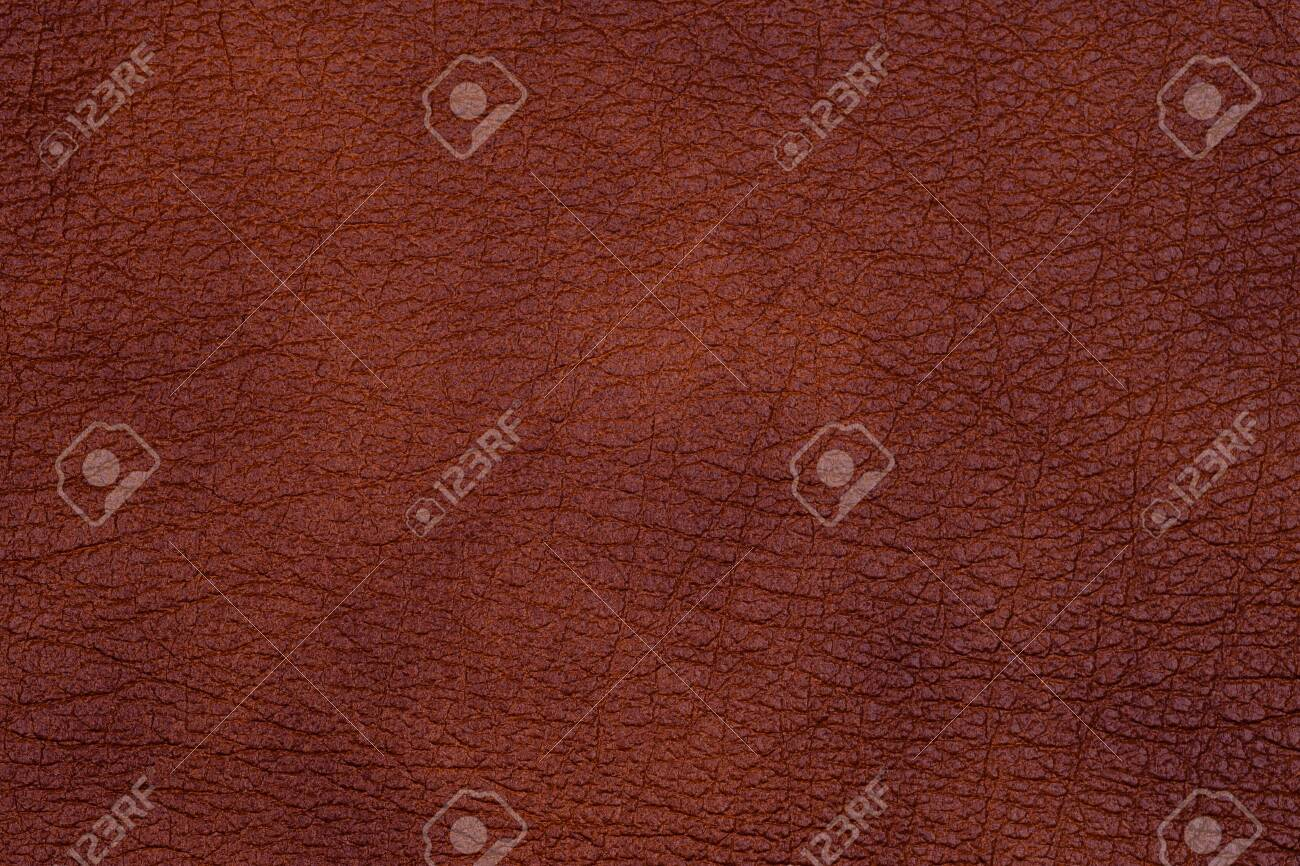 Natural dark leather abstract background detailed closeup. Top view. - 121452639