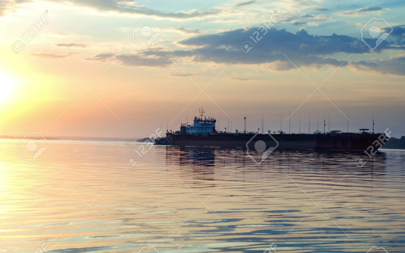 barge on river on suset background Stock Photo - 13445890