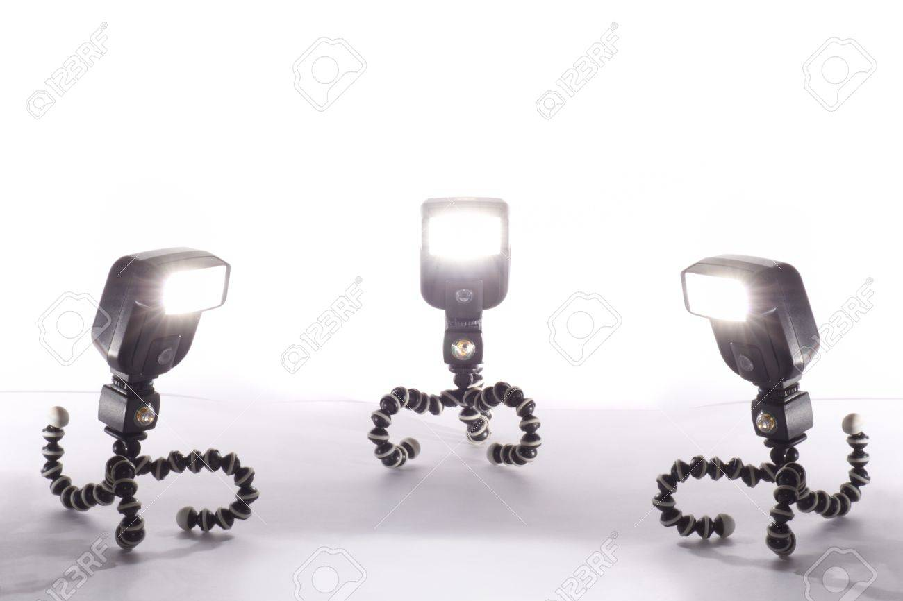 three camera flash isolated on white background Stock Photo - 16332752