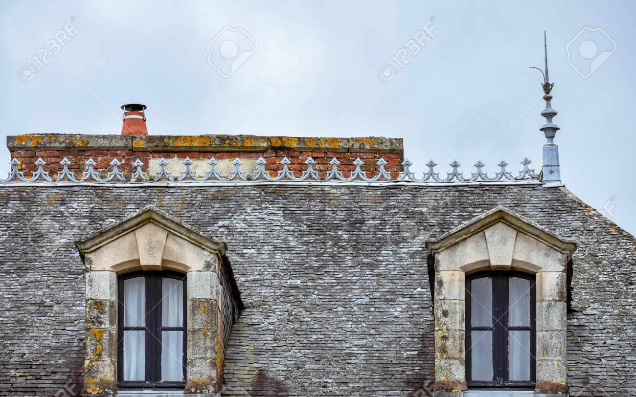 Dormer windows on slate roof and orange chimneys  Rochefort-en-Terre,