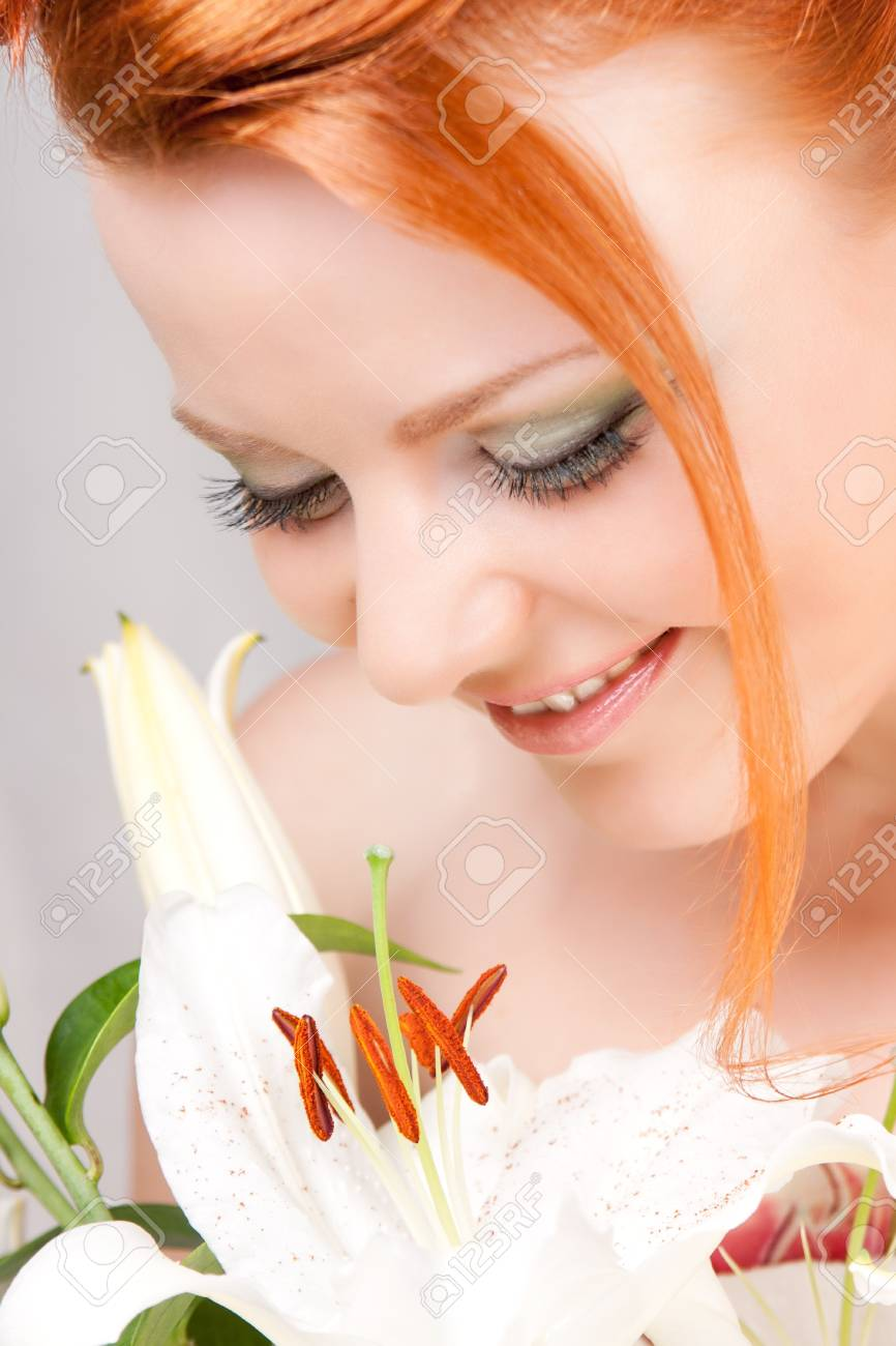 Smile of the girl with beautiful flowers Stock Photo - 10244325