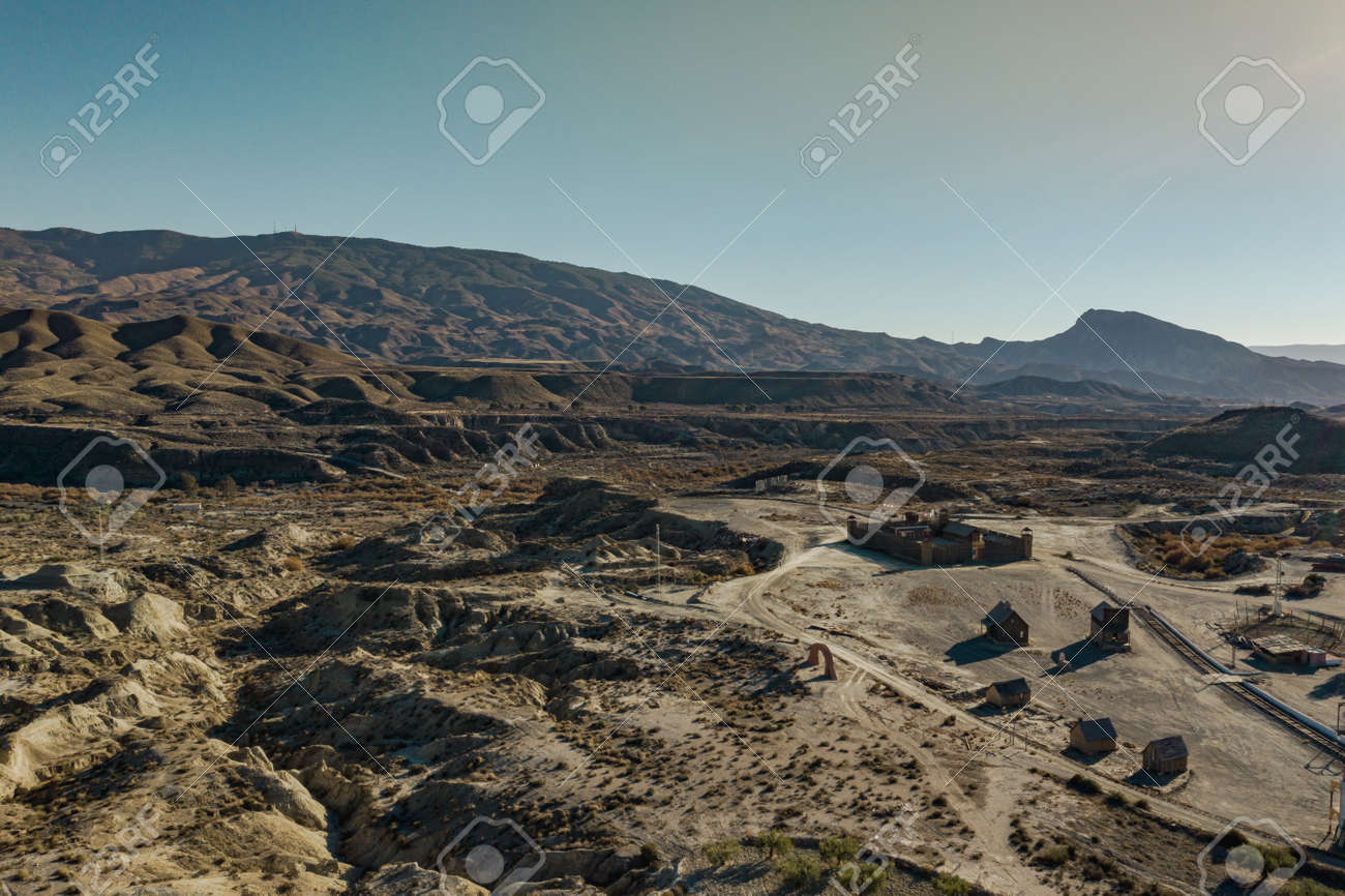 Drone above view of Tabernas Desert Landscape Texas Hollywood Fort Bravo the western style theme park in Almeria Andalusia Spain Europe - 165004139
