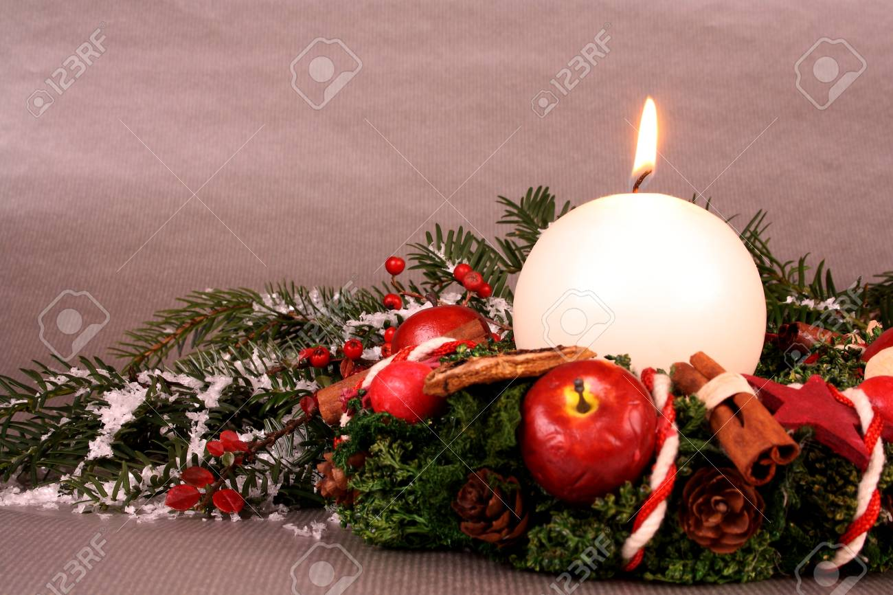 Christmas wreath with candle and Christmas decoration on silver background Stock Photo - 16535866
