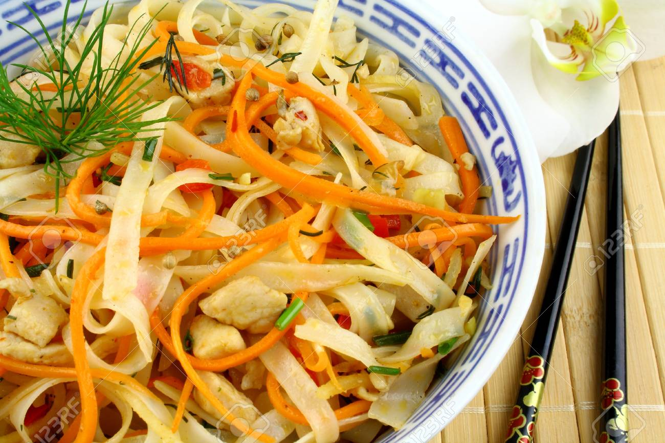 Rice noodle with chicken meat, chopsticks and orchid Stock Photo - 18702610