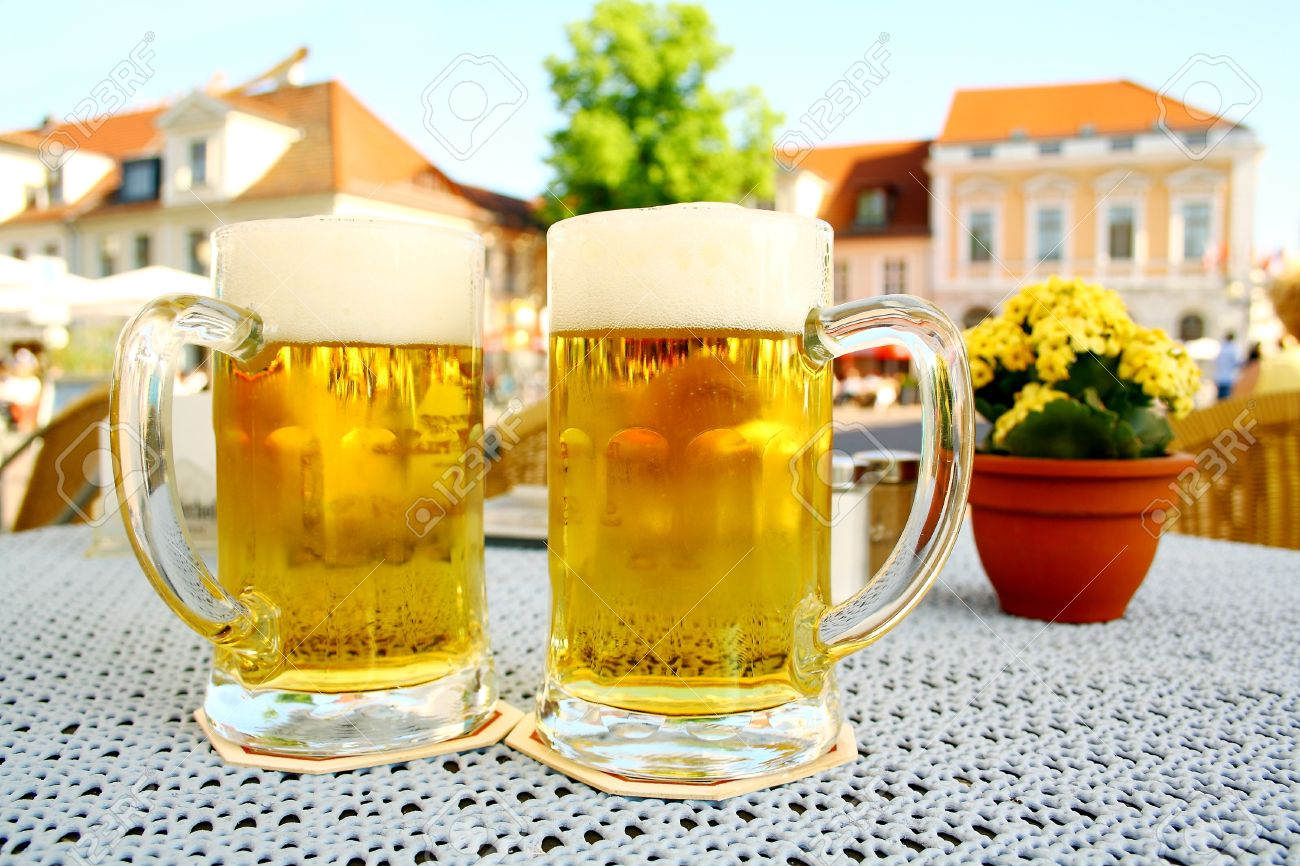 Two Steins Beer Garden In The City Soft Focus Stock Photo