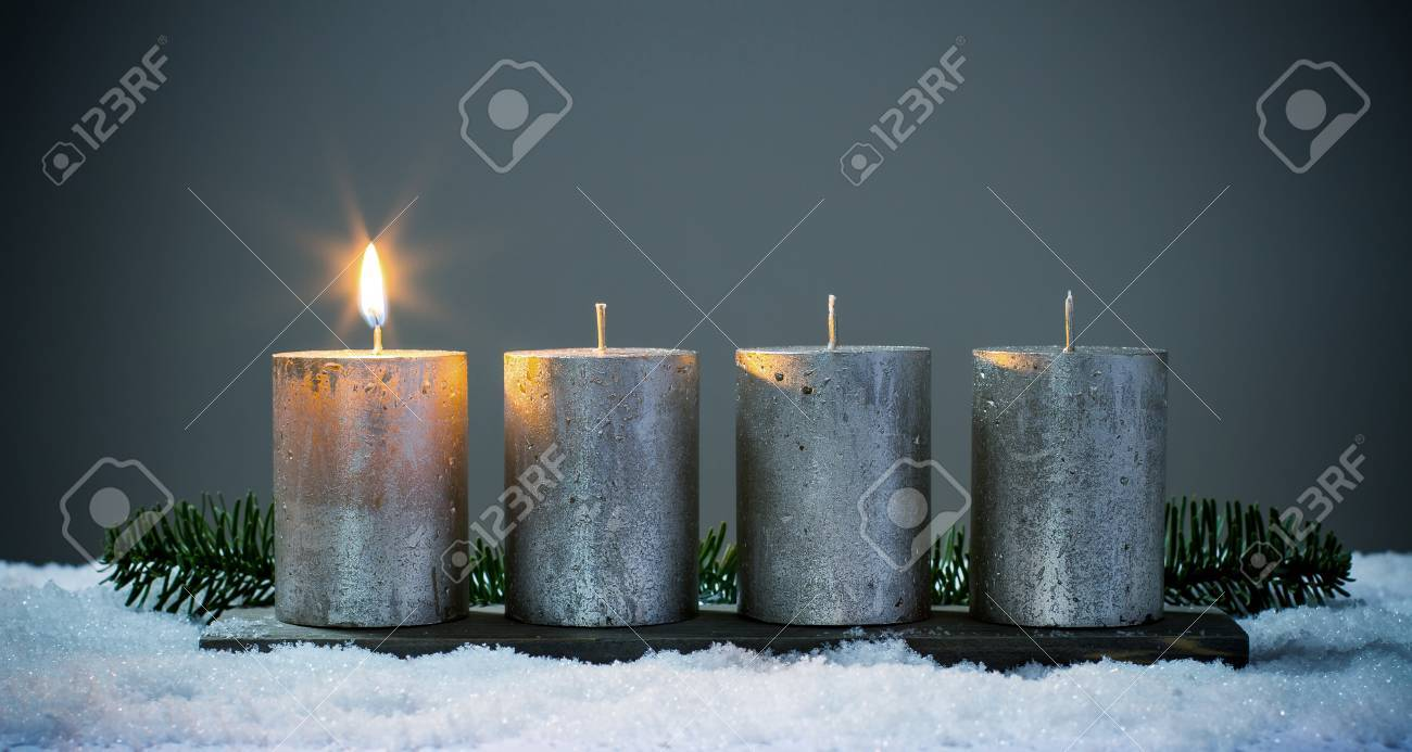 Light four advents candles with matches - 68805396