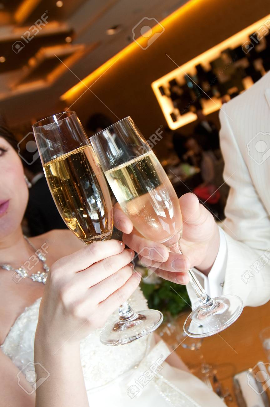 Cheers bride and groom toast at wedding reception