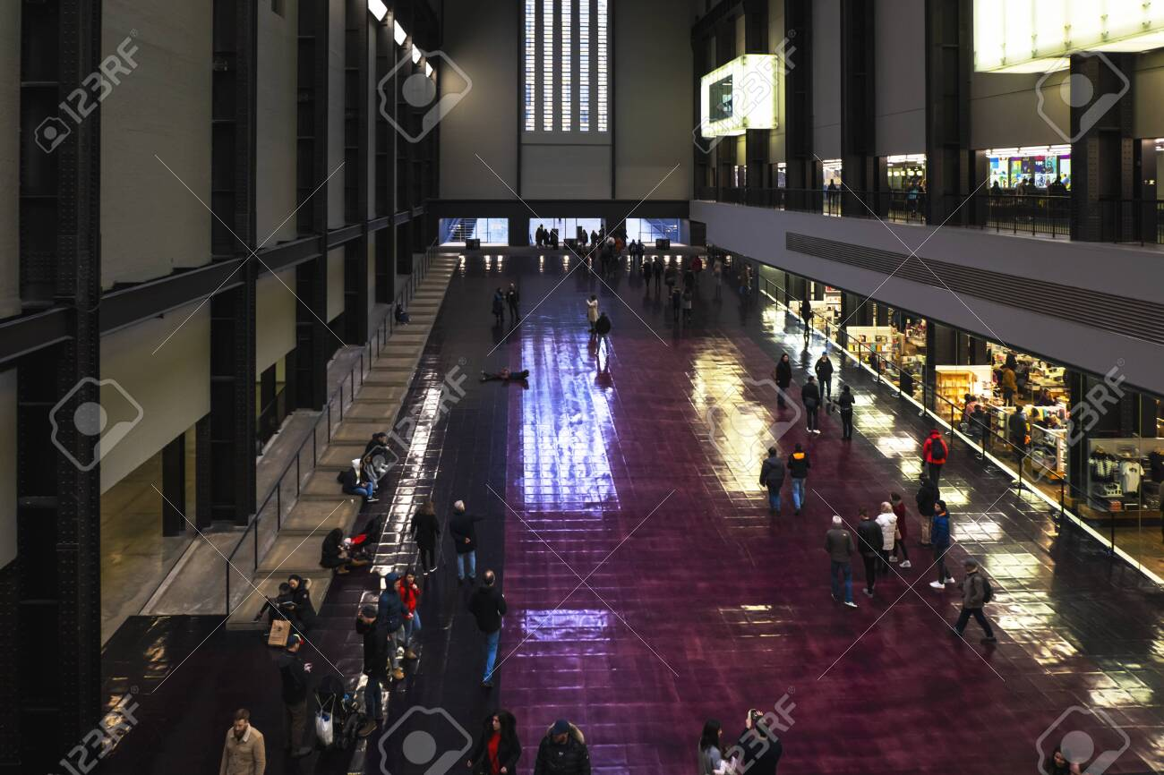People Walking Or Standing On The Floor In The Turbine Hall Of