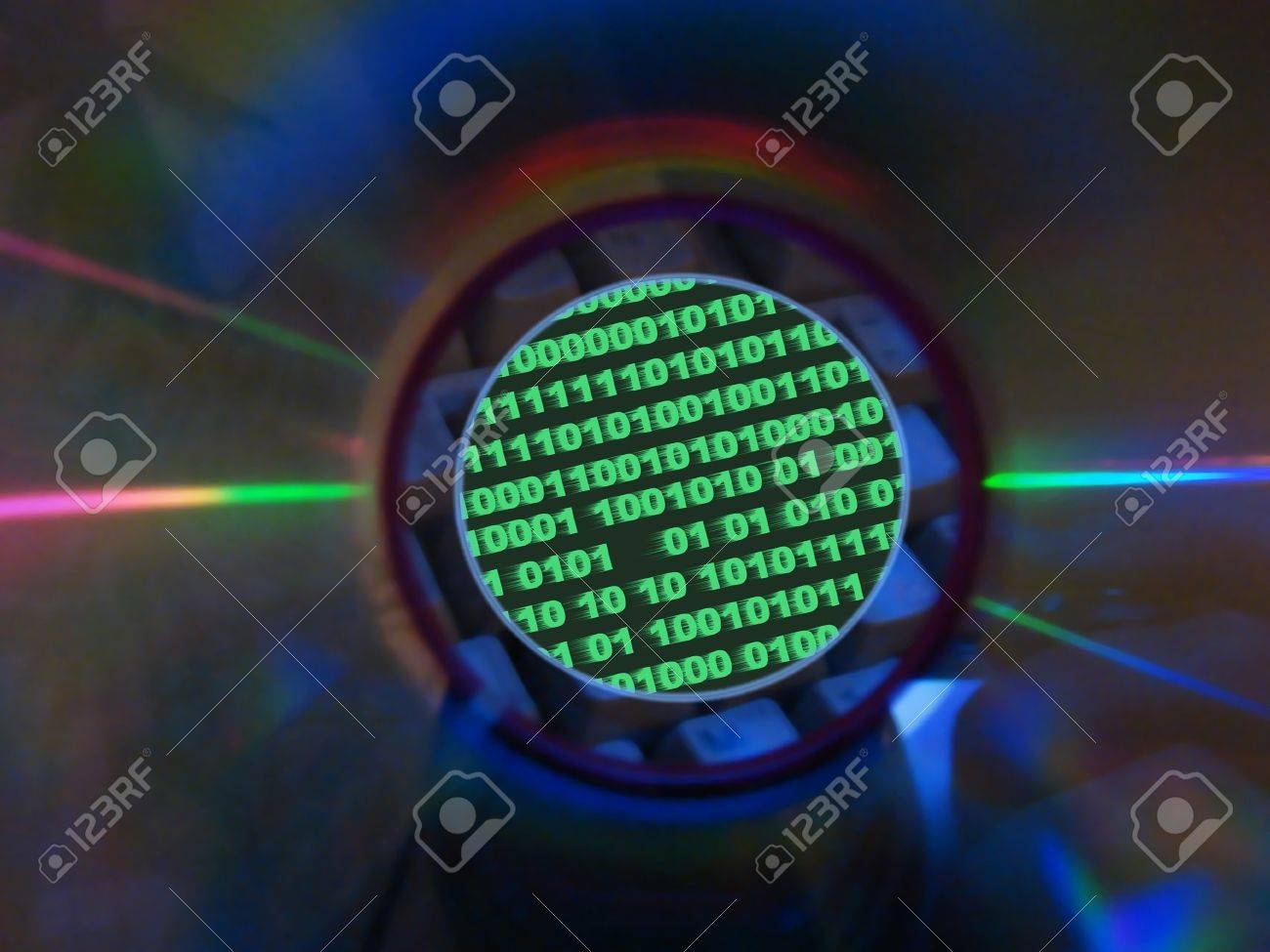 keyboard & binary code visible through compact disk hole Stock Photo - 8324947