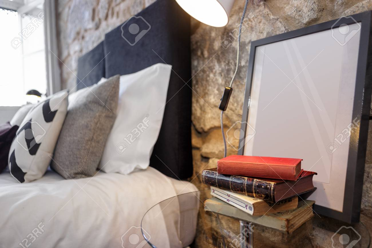 Glass Nightstand With Old Books