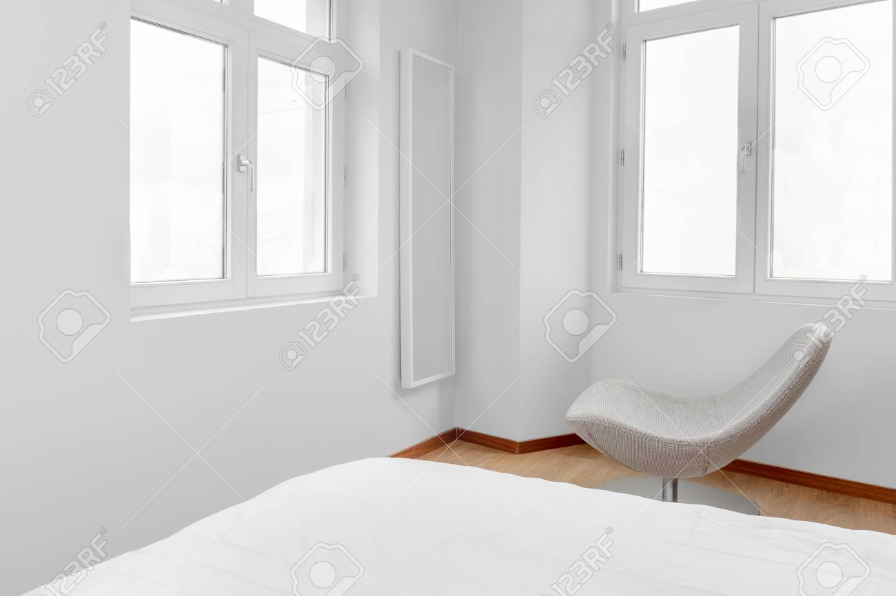 Stylish Chair In A White And Bright Bedroom Stock Photo, Picture And ...