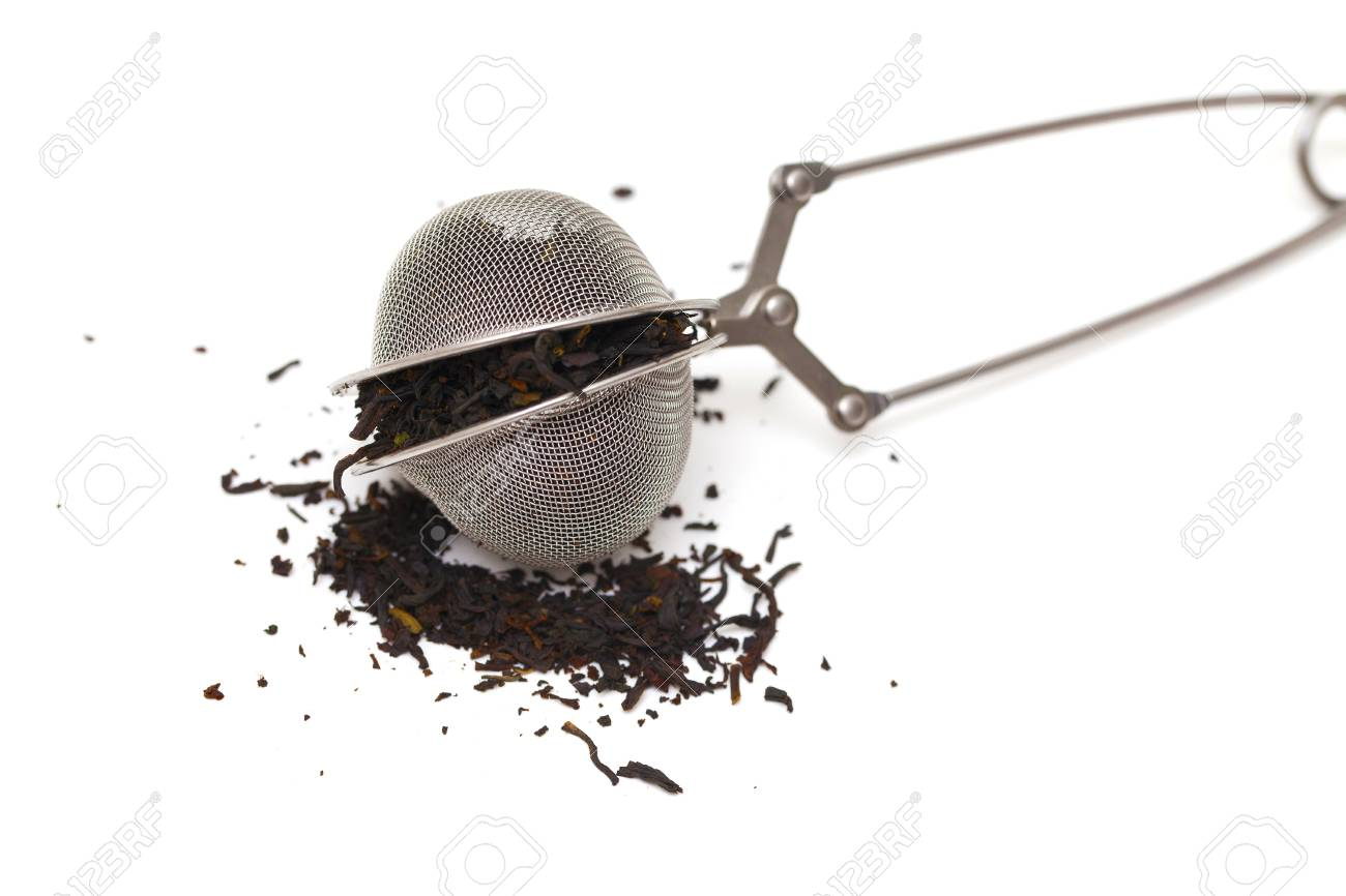 tea infuser filled with tea isolated Stock Photo - 14463731