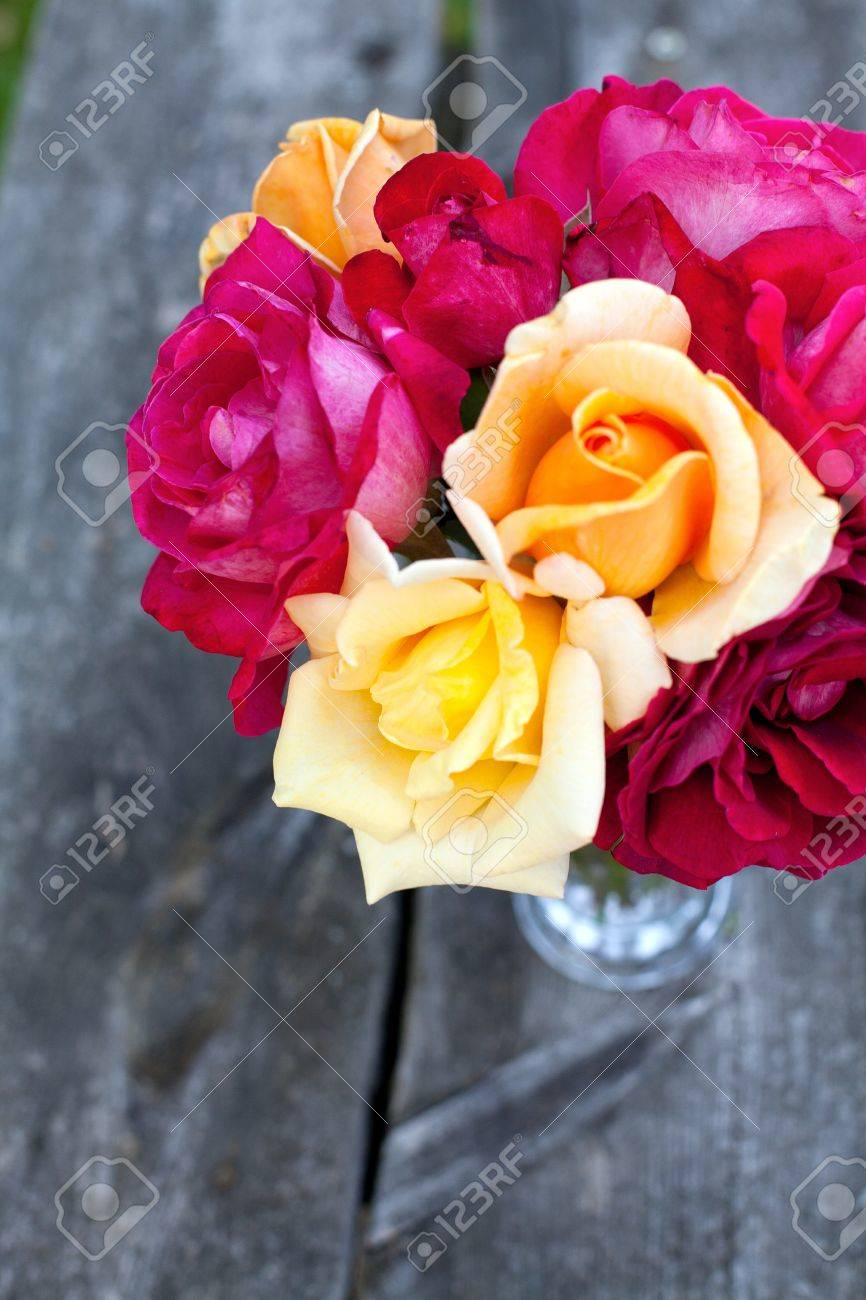 beautiful bouquet of different roses on wooden table Stock Photo - 14708944