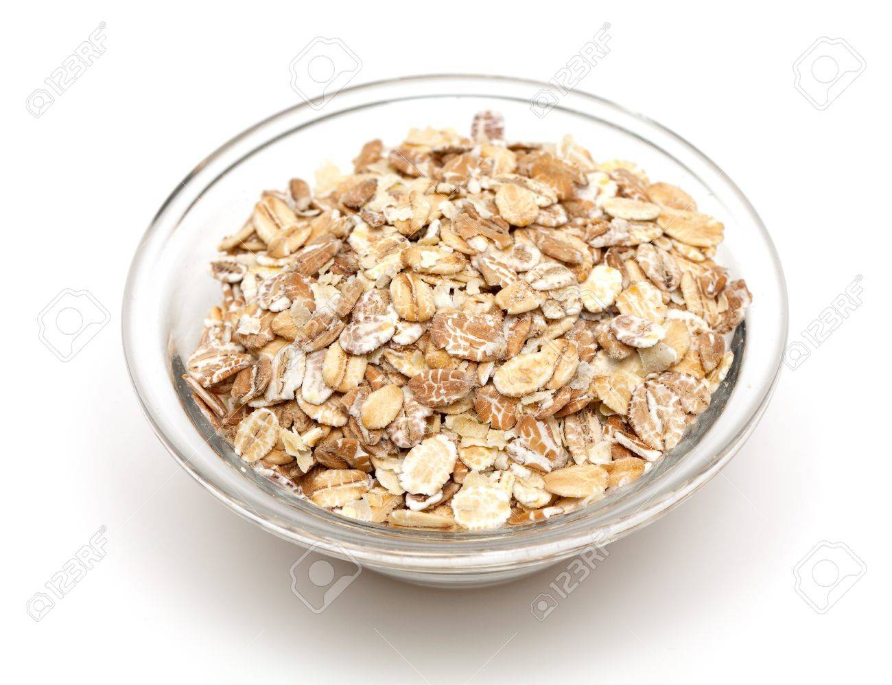 oat flakes in a glass bowl isolated on white backrgound Stock Photo - 18566535