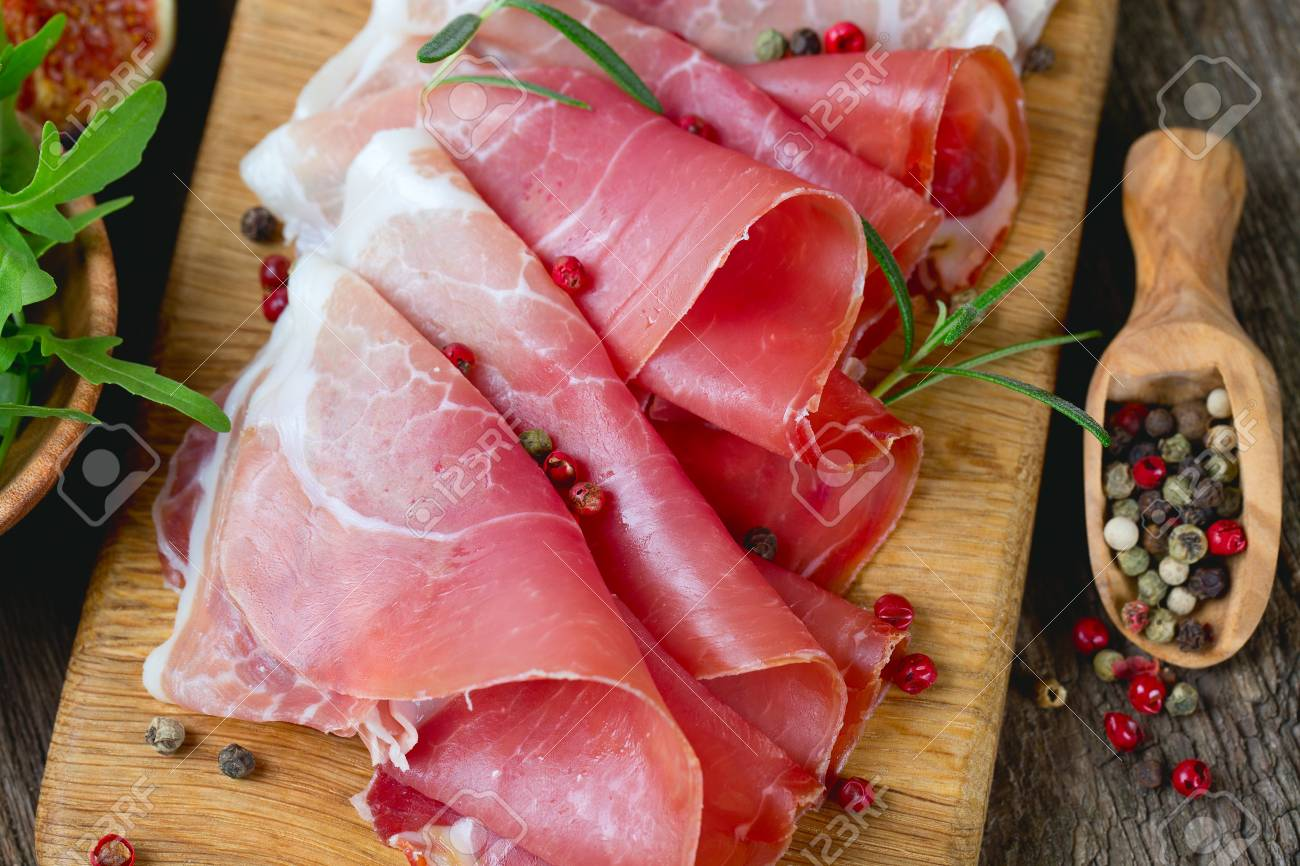 sliced prosciutto on a wooden board Stock Photo - 23639150
