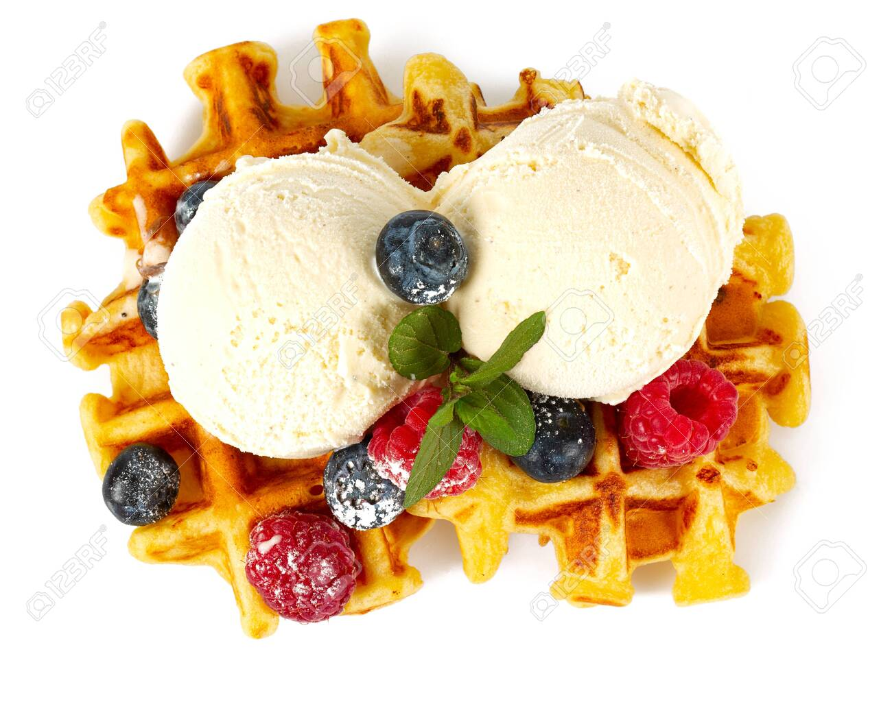 belgian waffles with ice cream and berries - 125216950