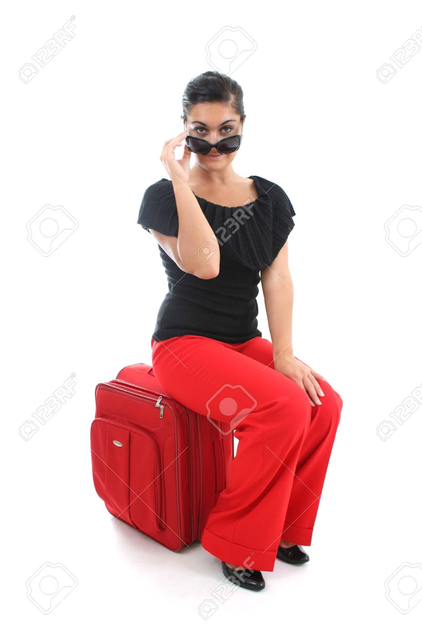 young businesswoman in sunglasses sitting on big suitcase Stock Photo - 7666771