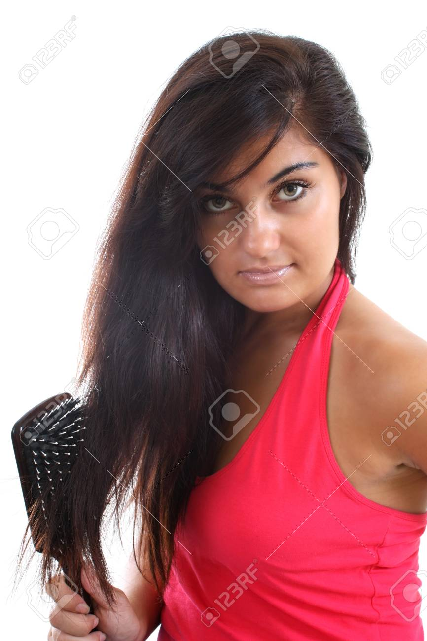 pretty woman in pink brushing her hair Stock Photo - 7667089