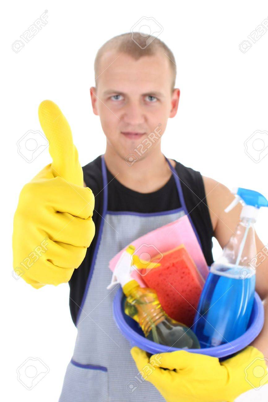 young man with cleaning supplies giving thumbs up. focus on hand Stock Photo - 7859520