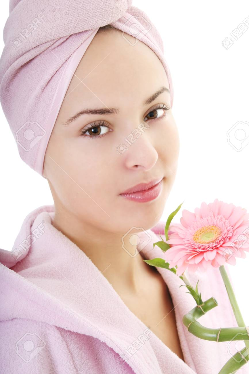 Young beautiful woman in bathrobe with gerberas and bamboo after bath Stock Photo - 8203536