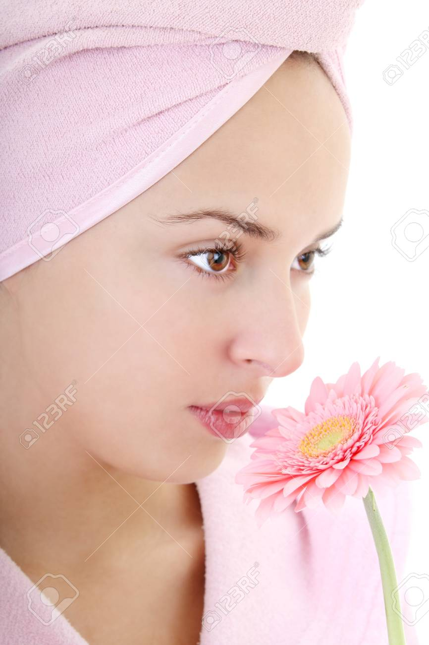 Portrait of young beautiful woman in bathrobe smelling gerberas Stock Photo - 8203533