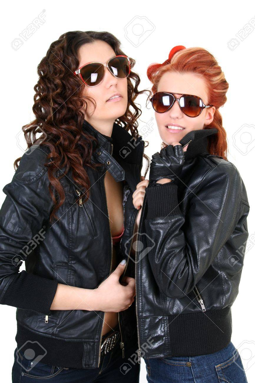 Two glamorous woman in leather jackets and sunglasses Stock Photo - 9450501