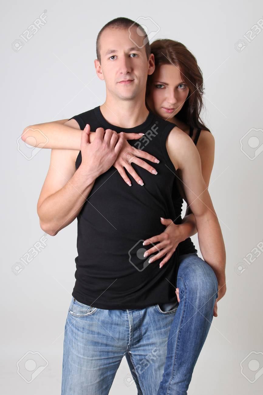 pretty woman hugging her boyfriend over white background Stock Photo - 15763703