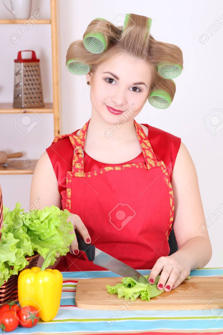 beautiful housewife cutting salad in the kitchen Stock Photo - 17467969