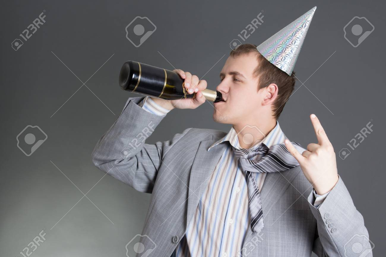 drunk bussinesman drinking champagne over grey background Stock Photo - 18499001
