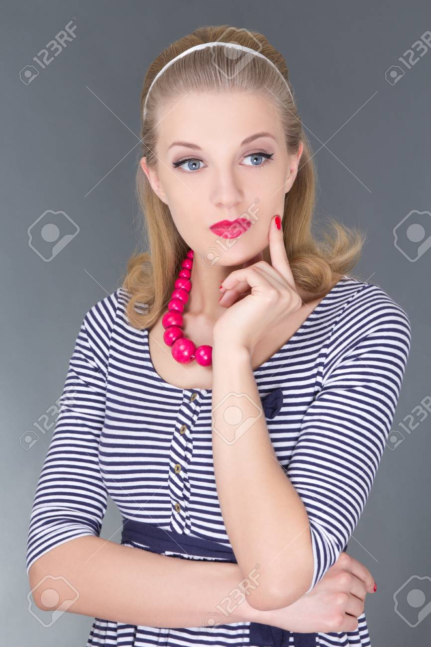 young attractive blondie pinup girl in striped dress dreaming Stock Photo - 18960036