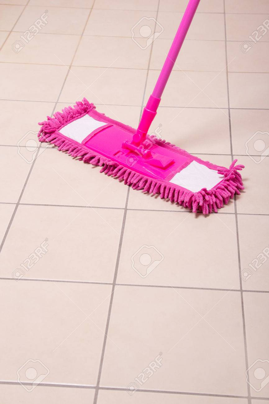 Mopping Tile Floor In House Bathroom Stock Photo Picture And