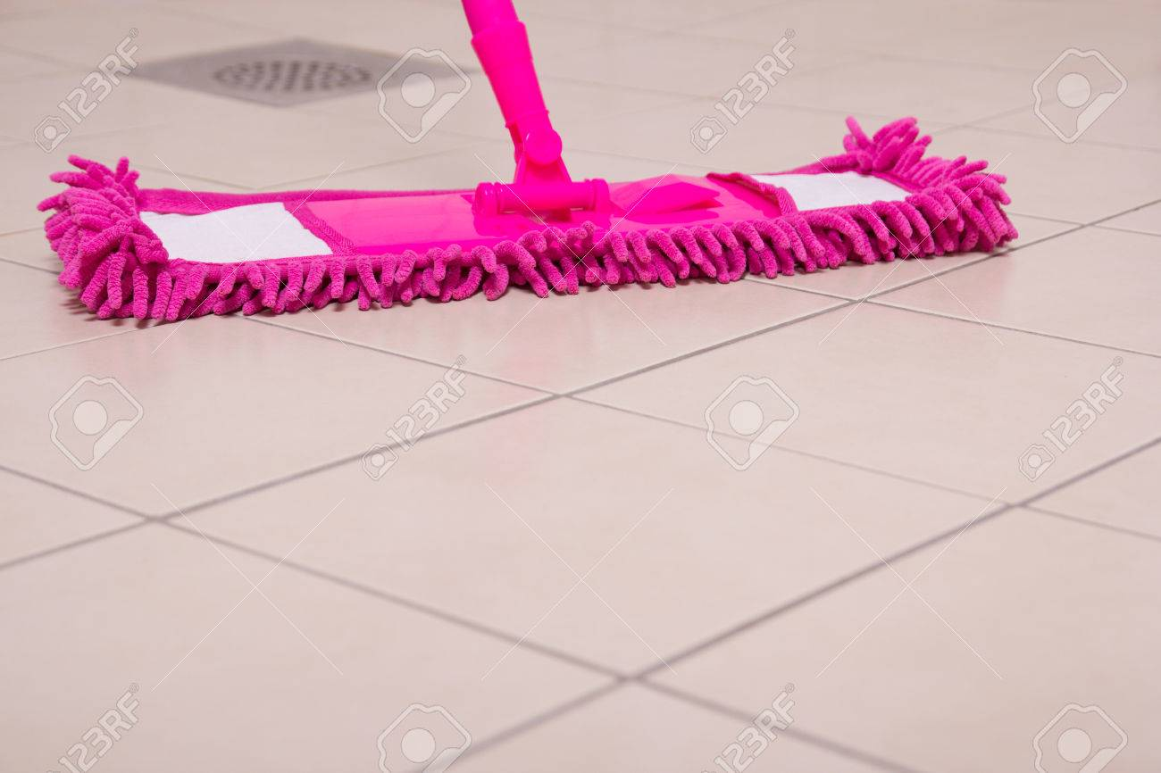 House tile floor cleaning with pink mop stock photo picture and house tile floor cleaning with pink mop stock photo 23522175 dailygadgetfo Image collections