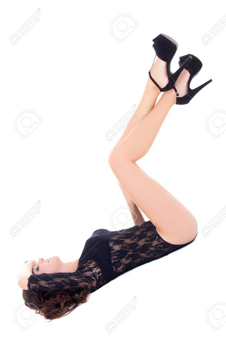 a9cea99ea4 Stock Photo - young beautiful sexy woman in black lace lingerie lying  isolated on white background