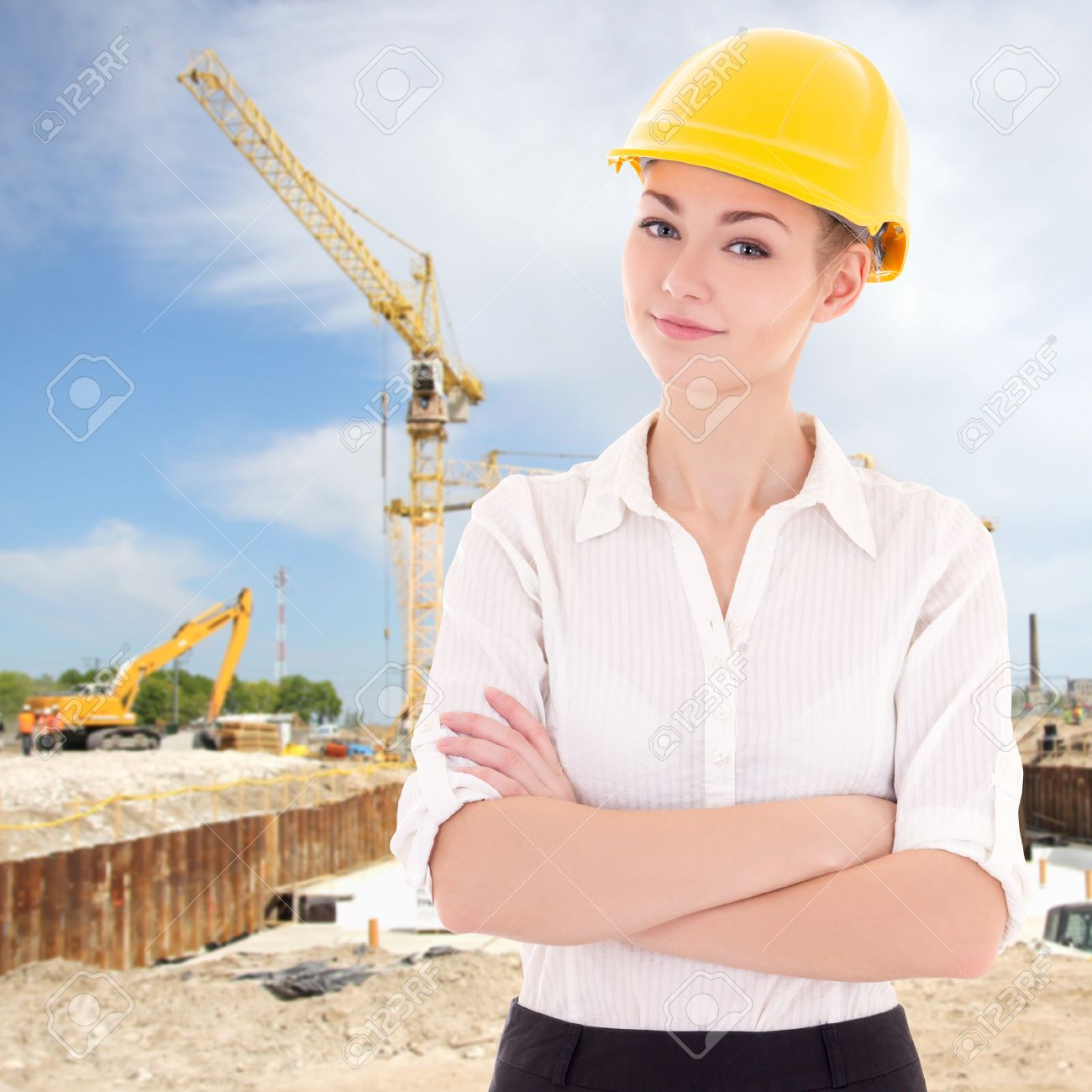 Portrait Of Business Woman Architect In Yellow Builder Helmet At  Construction Site Stock Photo   38194044