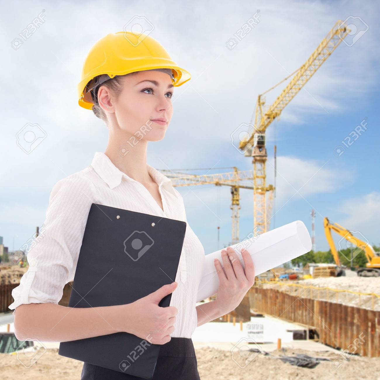 Beautiful Business Woman Architect In Yellow Builder Helmet At Construction  Site Stock Photo   38194048