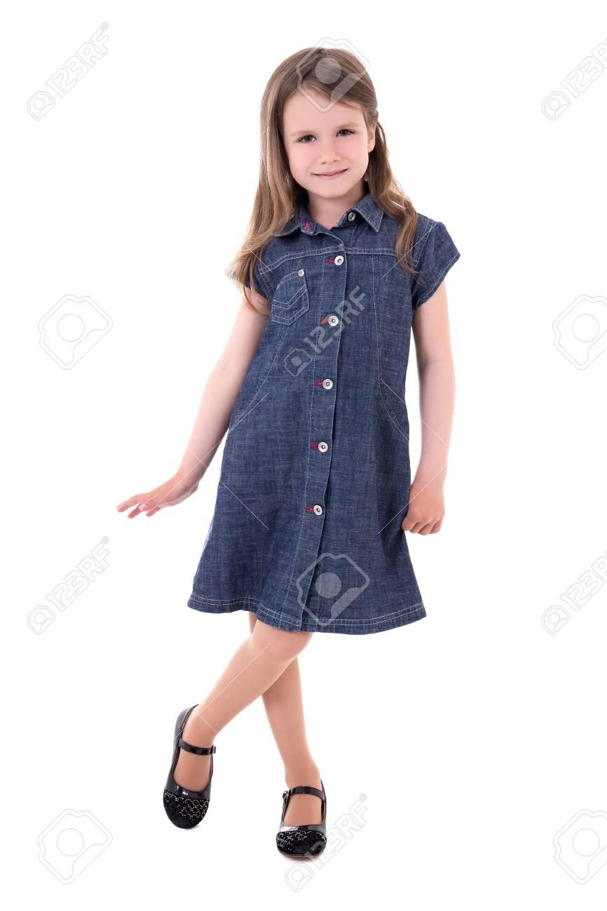 d83d9d80e63 cute little girl in denim dress posing isolated on white background Stock  Photo - 41793349