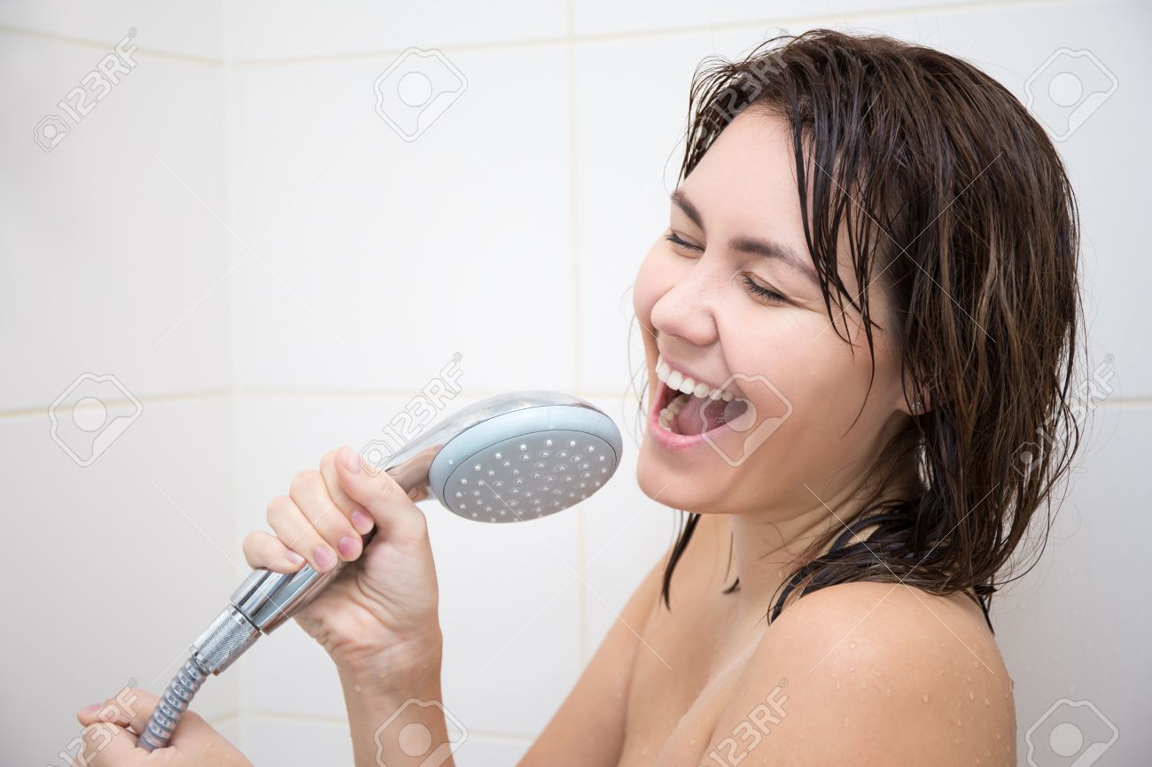 Portrait Of Happy Funny Woman Singing In Shower Stock Photo