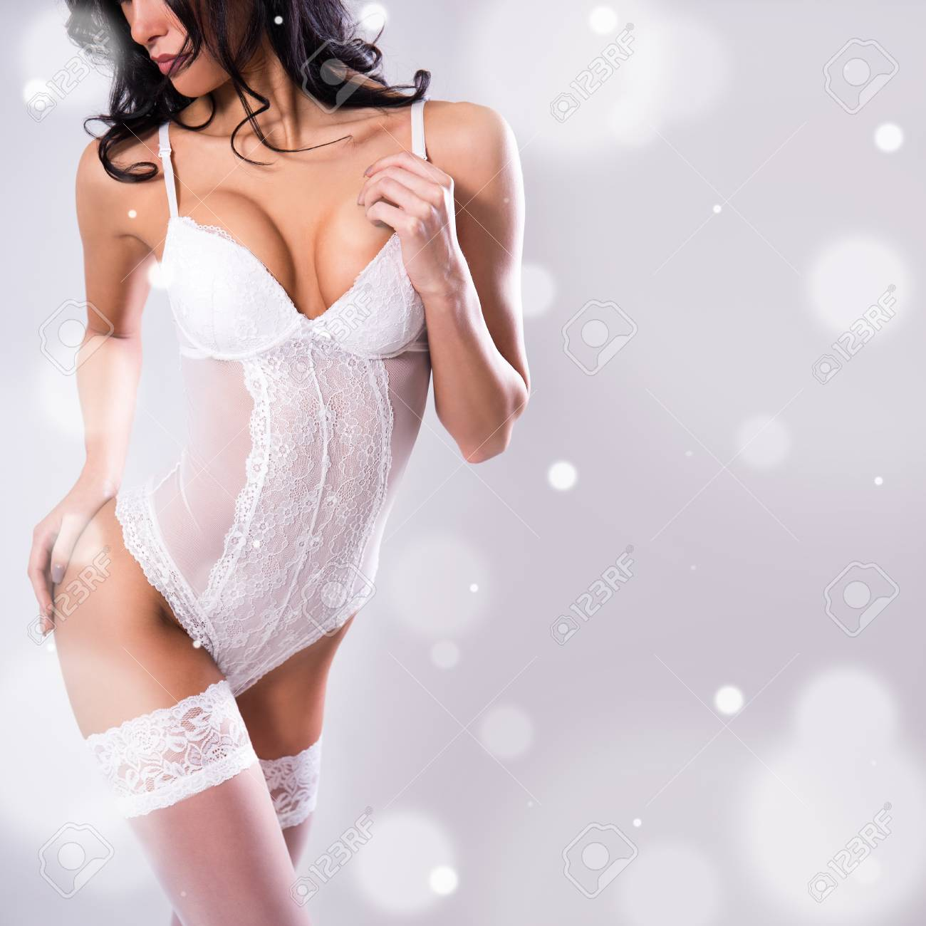 ecd554cf7 sexy female body in white lace bodysuit over gray background with falling  snow Stock Photo -