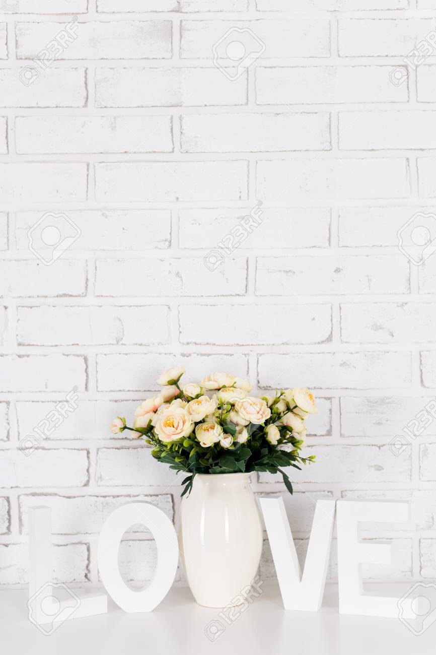 Rose Flowers And Wooden Word Love Over White Brick Wall Background Stock Photo Picture And Royalty Free Image Image 85882353