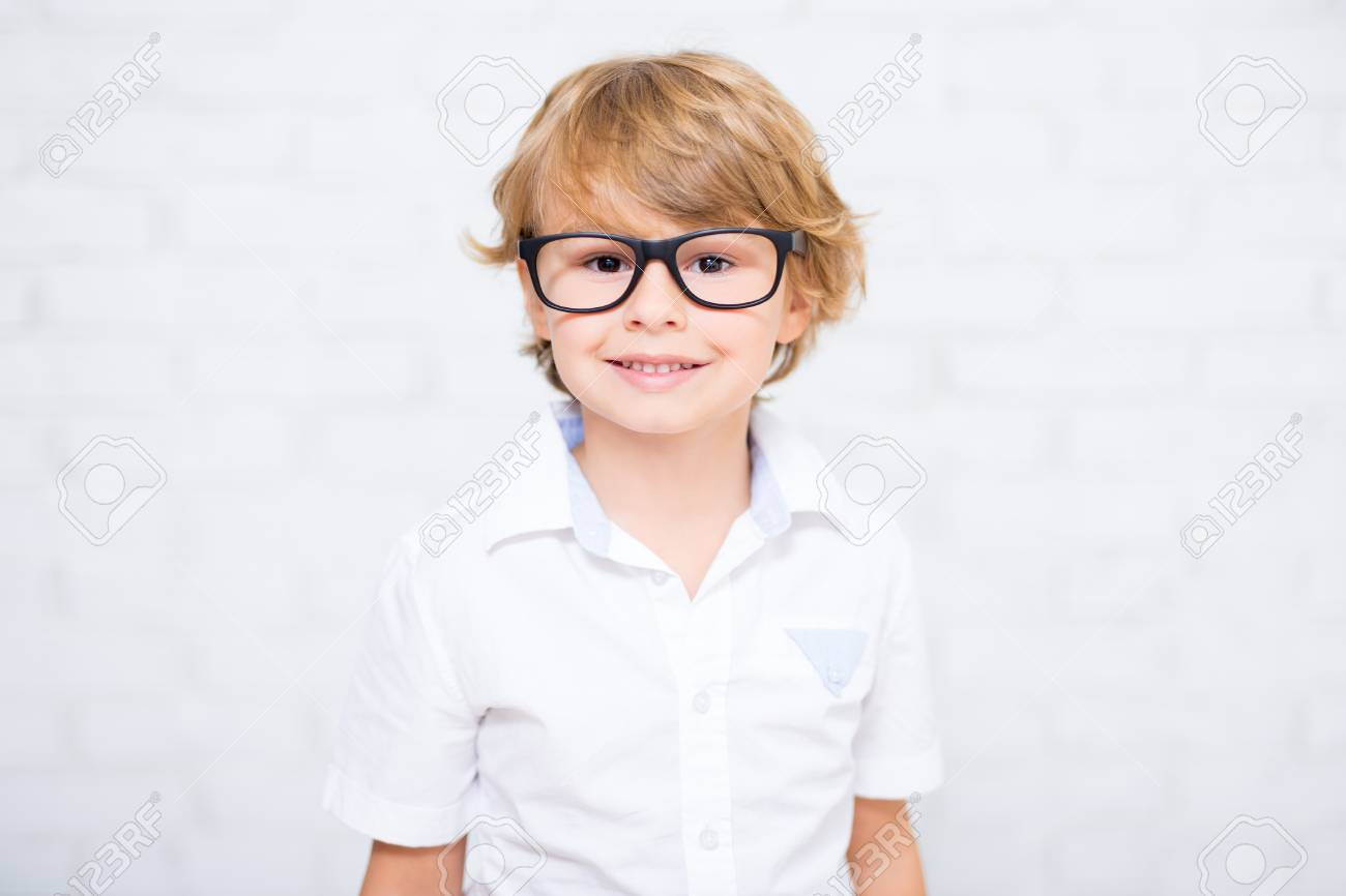 976667769b close up portrait of cute little boy in glasses over white Stock Photo -  87212994