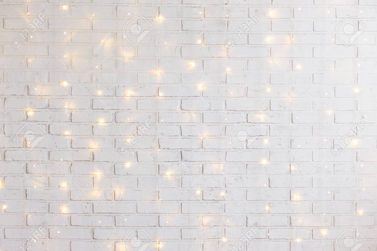 White Brick Wall Christmas Background With Shiny Lights Stock Photo Picture And Royalty Free Image Image 89588921