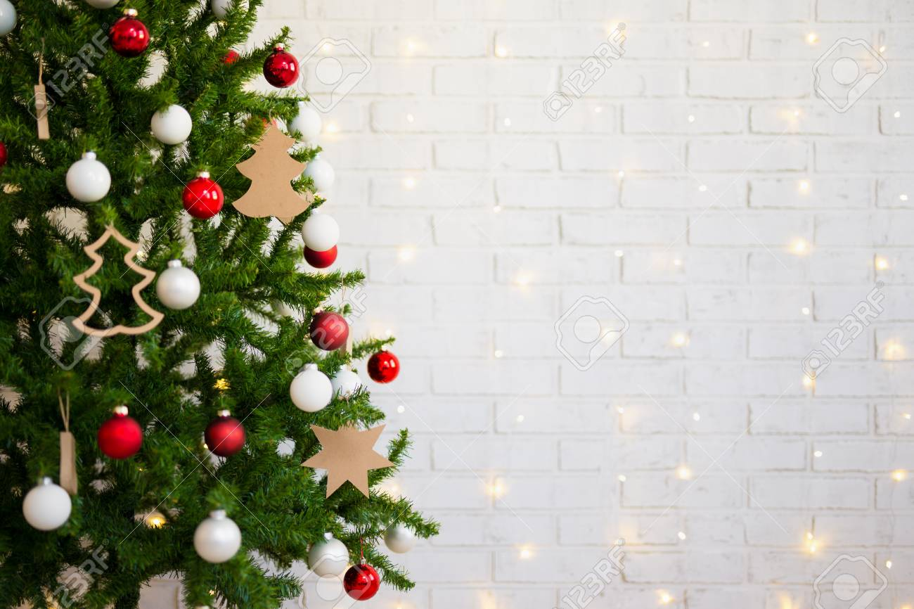 Christmas Tree Over White Brick Wall With Shiny Lights Stock Photo Picture And Royalty Free Image Image 89589020