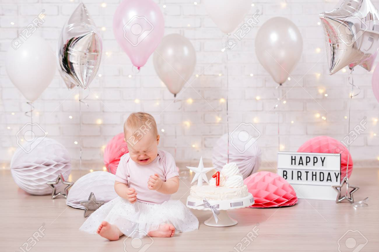 First Birthday Party Concept Sad Little Baby Girl Crying With Stock Photo Picture And Royalty Free Image Image 118034135