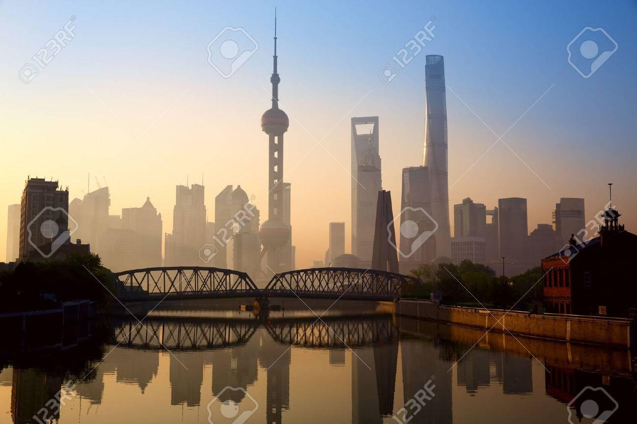 Shanghai skyline at sunrise with historical Waibaidu bridge China - 39967659