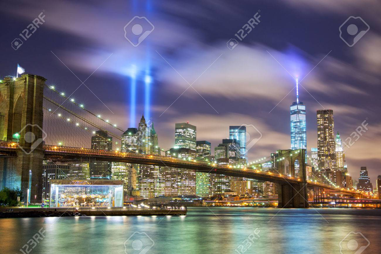 Manhattan skyline with Brooklyn Bridge and the Towers of Lights (Tribute in Light) in New York City - 43614315