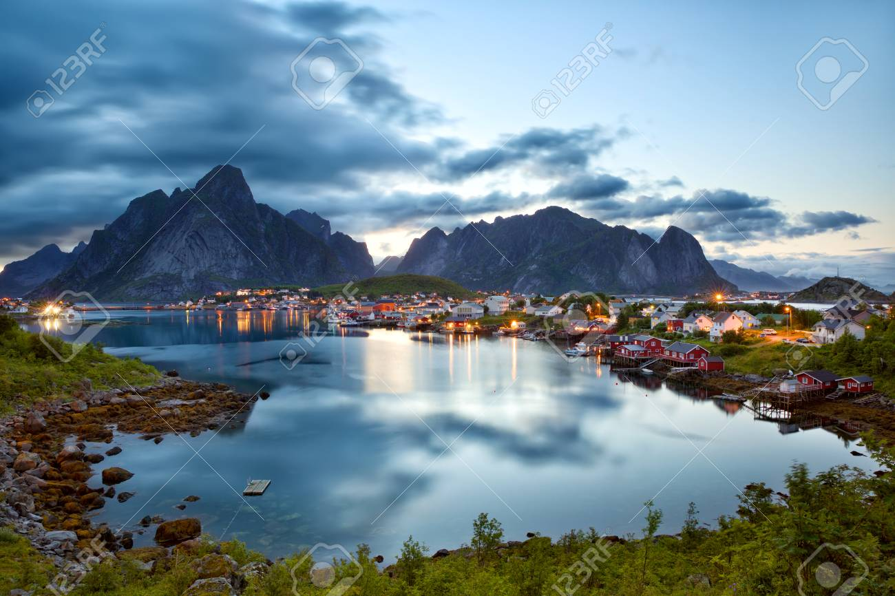 reine fishing village at dusk in lofoten islands, norway stock photo